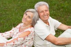 Honey elderly couple went to the nature. Charming elderly couple went to the nature on weekends Royalty Free Stock Image