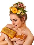 Honey facial mask with fresh fruits and honeycombs for hair . Stock Photo