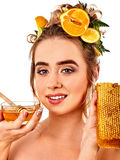Honey facial mask with fresh fruits and honeycombs for hair . Royalty Free Stock Photos