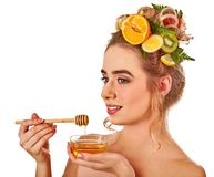 Honey facial mask with fresh fruits and honeycombs for hair. Stock Photo