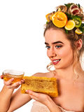 Honey facial mask with fresh fruits and honeycombs for hair . Royalty Free Stock Photo