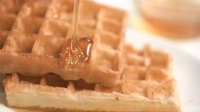 Honey falling in super slow motion Royalty Free Stock Images