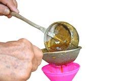 Honey Filtration Process a isolé sur le fond blanc photographie stock libre de droits