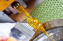 Honey flow. Ing from honey extractors Royalty Free Stock Photo