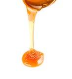 Honey flow isolated. On white Royalty Free Stock Photo