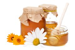 Honey and flowers Royalty Free Stock Photos