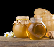Honey and flowers on black Stock Image