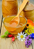 Honey with flowers and briar on the board royalty free stock photo