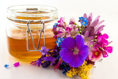 Honey and flowers Royalty Free Stock Photography