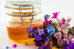 Honey and flowers Stock Image