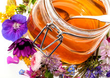 Honey and flowers Royalty Free Stock Photo