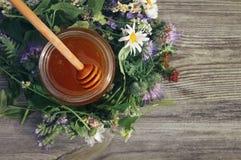 Honey with flowers Stock Photos
