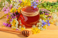 Honey with flowers Stock Image