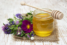 Honey with flowers Royalty Free Stock Photo