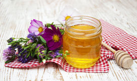 Honey with flowers Stock Images