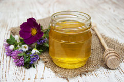 Honey with flowers Stock Photo