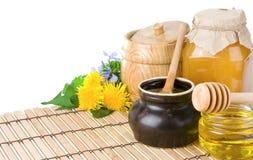 Honey, flowers, spike isolated on white. Honey, flowers, spike isolated on table Royalty Free Stock Image