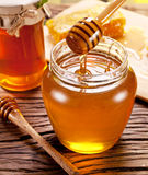 Honey flowing into glass. Royalty Free Stock Photo