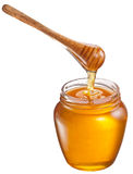 Honey flowing into glass jar. Stock Photography