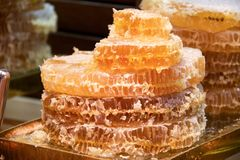 Honey flowing from the honeycombs group Royalty Free Stock Image