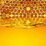 Honey flowing  from honeycombs and  wave Royalty Free Stock Image