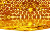 Honey flowing  from honeycombs and a wave Royalty Free Stock Images