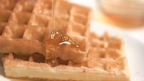 Honey flowing in super slow motion Stock Photos