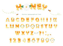 Honey font design. Glossy sweet ABC letters and numbers isolated on white. Vector Stock Images