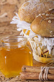 Honey and fresh bread and cinnamon. On the table Royalty Free Stock Image