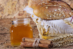 Honey and fresh bread and cinnamon. On the table Stock Photography