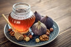 Honey with fresh figs. And nuts on wooden background closeup Royalty Free Stock Photos