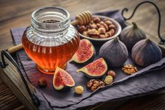 Honey with fresh figs and nuts Stock Photography