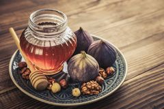 Honey with fresh figs Stock Photo