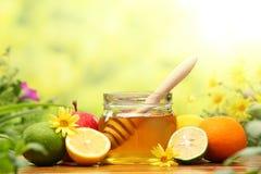 Honey and fresh fruits stock photo