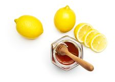 Honey and fresh lemon Stock Photos