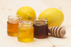 Honey and fresh lemons Royalty Free Stock Image