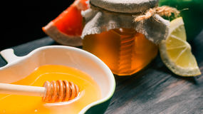 Honey and fruit Royalty Free Stock Photos