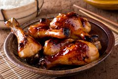 Honey Garlic Chicken. A bowl of delicious honey garlic chicken drumsticks with rice stock photography