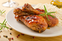 Honey Garlic Glazed Chicken. A plate of honey garlic glazed chicken drumsticks with rice Stock Images