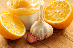 Honey garlic and lemon on wooden rustic table. Stock Images
