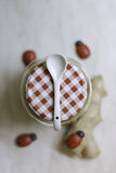 Honey Ginger and ceramic spoon Stock Photo