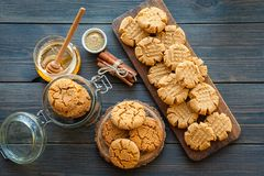 Honey ginger cookies with milk on a black background Stock Photography