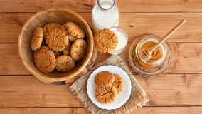 Honey ginger cookies with milk on a rustic background Royalty Free Stock Images