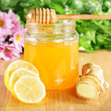 Honey, ginger, lemon on a wooden surface Royalty Free Stock Images