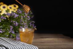 Honey in Glass with Bee Royalty Free Stock Photo