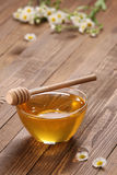 Honey in a glass bowl Stock Photos