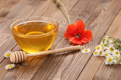 Honey in a glass bowl royalty free stock images