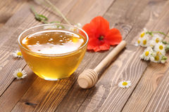 Honey in a glass bowl stock image