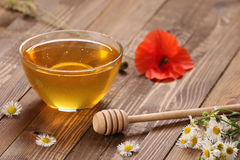 Honey in a glass bowl royalty free stock photos