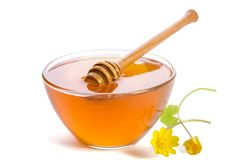 Honey in the glass bowl with dipper stock images